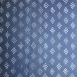 natural artisanal hand dyed blue and white indigo cotton fabric textile geometric diamond dot pattern