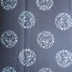 natural artisanal hand dyed blue and white indigo cotton fabric textile geometric round dragon pattern
