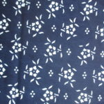 natural artisanal hand dyed blue and white indigo cotton fabric textile floral pattern