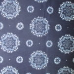 natural artisanal hand dyed blue and white indigo cotton fabric textile geometric floral pattern