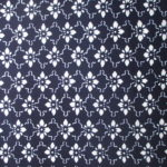 natural artisanal hand dyed blue and white indigo cotton fabric textile geometric floral leaf pattern