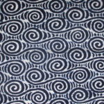 natural artisanal hand dyed blue and white indigo cotton fabric textile geometric wave pattern