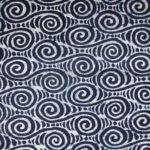 natural artisanal hand dyed blue and white indigo cotton fabric textile geometric wave pattern