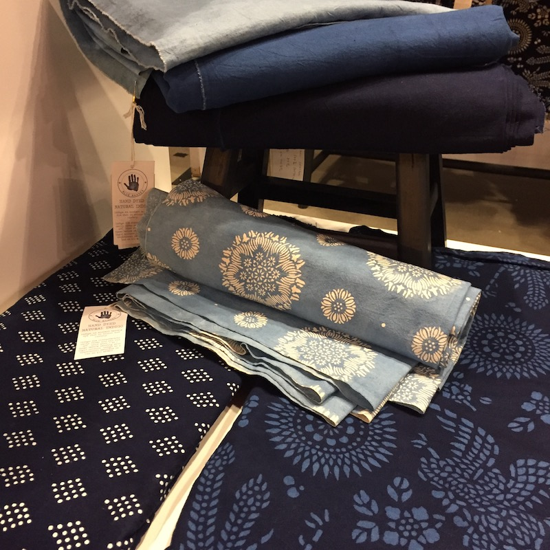 Artisanal indigo blue fabrics textiles hand dyed using natural indigo and resist paste materials locally sourced mens fashion interior decoration