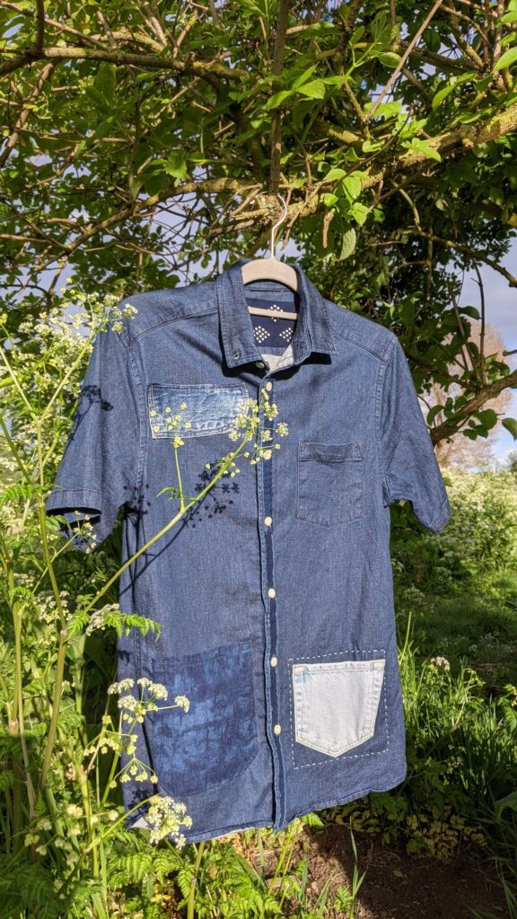 visible mended vintage clothing with indigo patches
